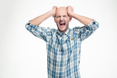 Depressed hysterical young man in checkered shirt screaming loudly Royalty Free Stock Photos