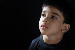 Depressed Indian Boy. Depressed Indian Little Boy looking up Royalty Free Stock Images