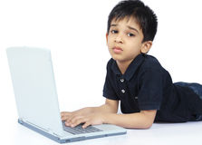 Depressed Indian Little Boy. With Laptop Stock Photo