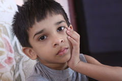 Depressed Indian Little Boy. Posing to Camera Royalty Free Stock Photos