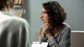 Depressed lady attending therapy session with psychologist, depressive state royalty free stock photography