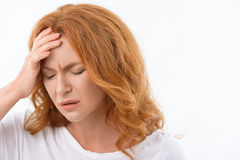 Depressed lady suffers from headache stock image