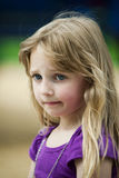 Depressed Little Girl. Upset Girl outside looking away Royalty Free Stock Images