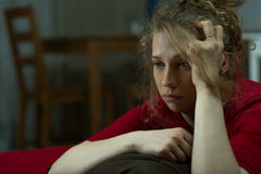 Depressed lone woman. Horizontal view of a young depressed woman being lonely Stock Photo
