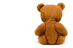 Depressed lonely old teddy isolated. Depressed lonely vintage teddy isolated, from behind Royalty Free Stock Images