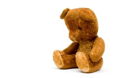 Depressed lonely old teddy isolated. Depressed lonely vintage teddy isolated, with sad face Stock Photography