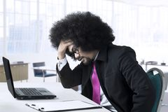 Depressed male entrepreneur in the office Royalty Free Stock Photography