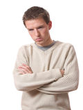Depressed man. Depressed young man looking down isolated over white background Stock Image