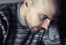 Depressed man. Young man sitting looking sad Stock Photo