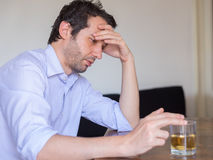 Depressed man abusing of alcohol Stock Images