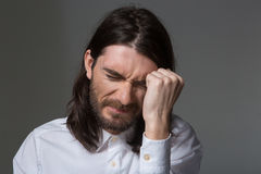 Depressed man with beard and long hair Stock Photography