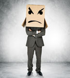 Depressed man with box over head. With crossed arms stock photo