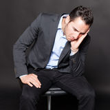 Depressed man on a chair Royalty Free Stock Photos