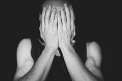 Depressed man cover his face with his hands Royalty Free Stock Image