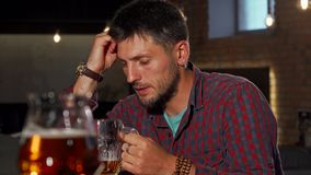 Free Depressed Man Drinking Alone At The Bar Stock Images - 131611304