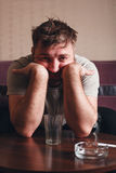 Depressed man after hard drinking. Stock Image
