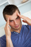 Depressed man having a headache Royalty Free Stock Image