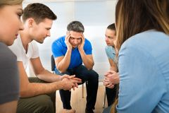 Depressed man with his friends Royalty Free Stock Photography