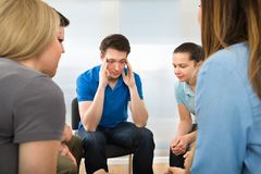 Depressed man with his friends Royalty Free Stock Photos