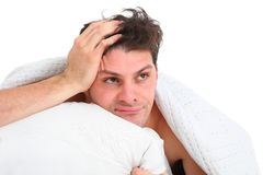 Depressed man lying in bed Stock Photos