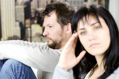 Depressed man not looking at wife after fight Royalty Free Stock Photo