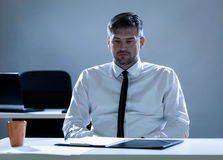 Depressed man in the office Royalty Free Stock Image