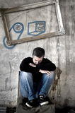Depressed man sitting on a chair Royalty Free Stock Photography