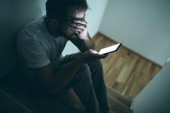 Free Depressed Man Sitting In The Dark Royalty Free Stock Photos - 210563568