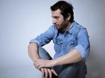 Depressed man studio shot stock photo