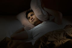 Depressed man suffering from insomnia stock photo