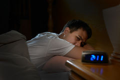 Depressed man suffering from insomnia stock image