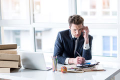 Depressed man in suit is talking on smartphone royalty free stock photos