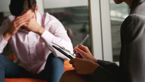 Depressed man talking to counselor. During therapy stock video footage