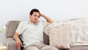 Depressed man thinking on the sofa Stock Image