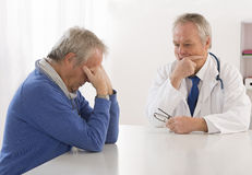 Depressed man visiting doctor Royalty Free Stock Photography