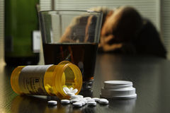 Depressed man with wine and prescription pills, horizontal Royalty Free Stock Photography