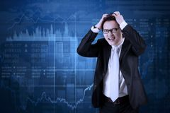 Depressed manager with declining trade stock. Picture of young male manager looks depressed with declining trade stock Stock Images