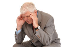 Depressed mature businessman holding head Royalty Free Stock Image
