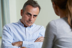 Depressed Mature Man Talking To Counsellor. Depressed Mature Man Talks To Counsellor stock photo
