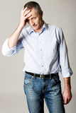 Depressed mature man touching his head.  Royalty Free Stock Photos