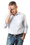 Depressed mature man. Touching his head Royalty Free Stock Photo