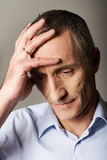 Depressed mature man touching his head Royalty Free Stock Photo