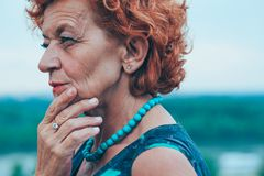 Depressed mature woman feeling alone outside Royalty Free Stock Photos