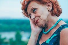 Depressed mature woman feeling alone outside Stock Photos