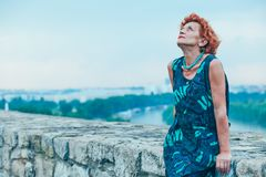 Depressed mature woman feeling alone outside Royalty Free Stock Photography