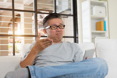 Depressed matured asian man Royalty Free Stock Photos