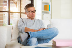 Depressed matured asian man Stock Photo