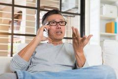 Depressed matured asian man Royalty Free Stock Image