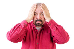 Depressed middle aged man with head in hands Stock Photo