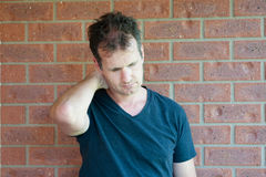 Depressed Middle Aged Man. Depressed Modern Middle Aged Australian Man Royalty Free Stock Photography